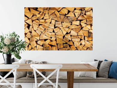 Woodpile in stack.Triangle shape. Wall of firewood