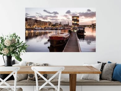 Antwerpen, Belgium, beautiful night view of modern Eilandje area and port. Small island district and sailing marine at sunset. Popular travel destination and tourist attraction