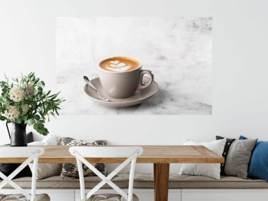 White cup of hot latte coffee with beautiful milk foam latte art texture isolated on bright marble background. Overhead view, copy space. Advertising for cafe menu. Coffee shop menu. Horizontal photo.