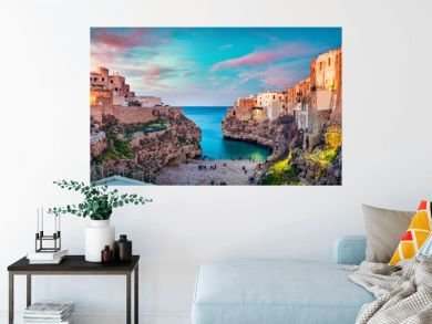 Spectacular spring cityscape of Polignano a Mare town, Puglia region, Italy, Europe. Colorful evening seascape of Adriatic sea. Traveling concept background..