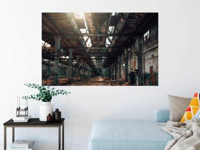 Abandoned creepy factory warehouse inside, deserted grunge industrial background.