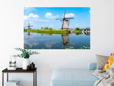 Panorama of the windmills and the reflection on water in Kinderdijk, a UNESCO World Heritage site in Rotterdam, Netherlands