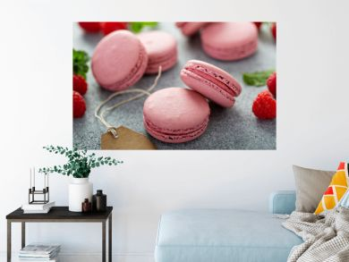 Raspberry macarons on gray table with fresh raspberries and price tags