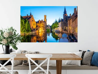 Bruges city skyline with canal at night in Belgium