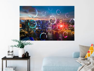 Hologram of abstract technology glowing icons, panoramic cityscape of Singapore at sunset, Asia. The concept of worlds technological changes. Double exposure.