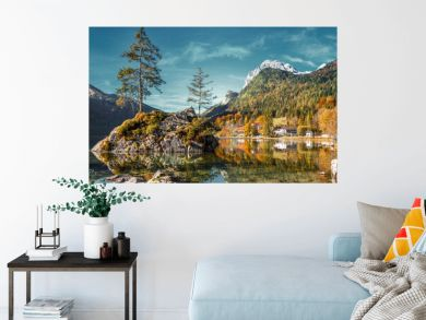 Fairy-tale lake Hintersee in sunny day, pine trees in sunlit. reflected in the water. Magic Painterly Scene in European Alps. Popular Photography Locations. Ideas for Great Travels. Instagram Filter.