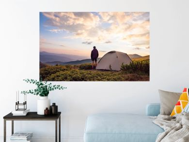 tourist tent and sportsman in mountains, summertime