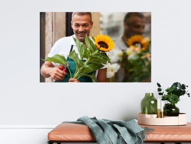 Portrait of florist next to his shop