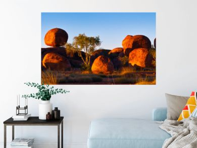 Devil's Marbles, Australia. The Devils Marbles are an extensive collection of red granite boulders in the Tennant Creek area of Australia's Northern Territory
