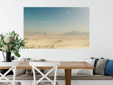 Sandy desert landscape with blue sky.