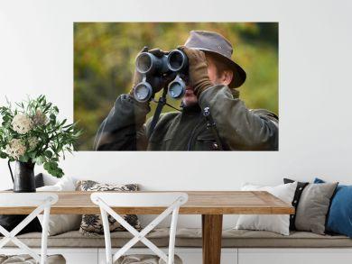 hunter looking through binoculars
