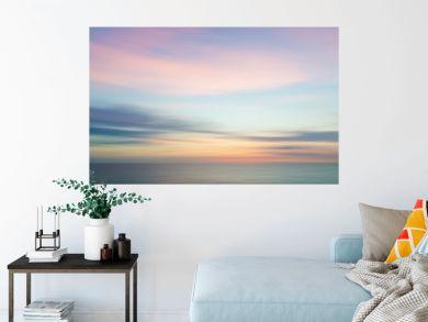 Blurred defocused sunset sky and ocean nature background.