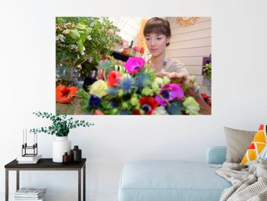 Female florist behind flowers