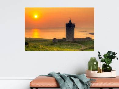 Doonegore castle at sunset in Doolin, Ireland