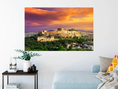 Acropolis with Parthenon. View through a frame with green plants, trees, ancient marbles and cityscape, Athens, Greece.