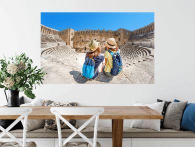 Two young girls student traveler taking selfie the ancient Greek amphitheater