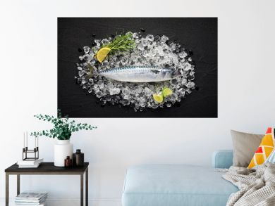 Fresh mackerel fish on ice on a black stone table top view