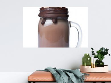 Crazy chocolate milk shake with whipped cream, cookies and black straw in glass jar