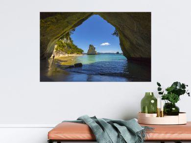 Landscape View through rock arch towards Te Hoho Rock at Cathedral Cove, Coromandel Peninsula - New Zealand