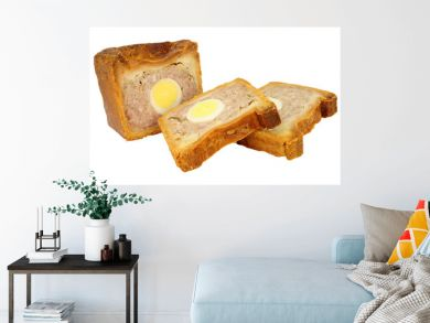 Traditional English savoury gala egg pork pie with crusty hot water pastry isolated on a white background