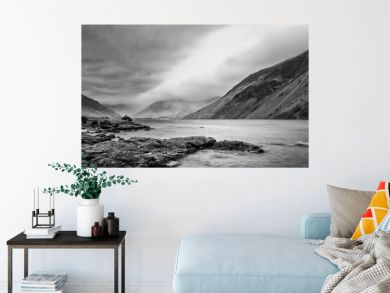 Stunning long exposure landscape image of Wast Water in UK Lake District during moody Spring evening in black and white