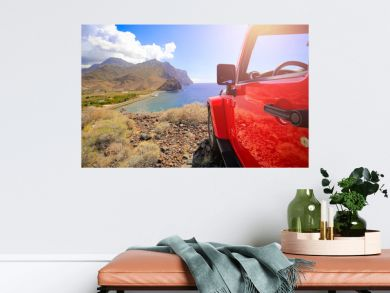 Red summer car and sea landscape