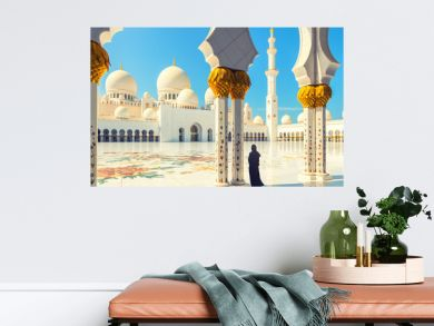 Woman wearing abaya dress at Sheikh Zayed Mosque, Abu Dhabi, UAE