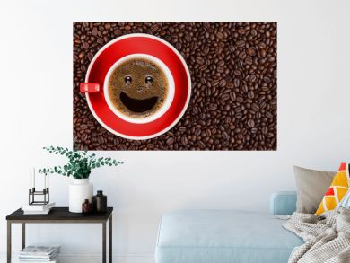 coffee background of hot black coffee with smile bubble in red cup on roasted arabica coffee beans background