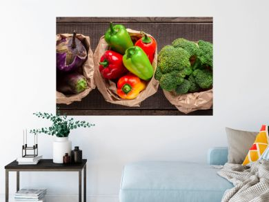 Collage of eco friendly and organic vegetables in paper bags