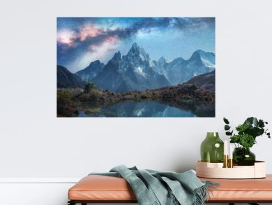 Milky Way over snowy mountains and lake at night. Landscape with snow covered high rocks and starry sky reflected in water in Nepal. Sky with stars. Fantastic view with bright milky way in Himalayas