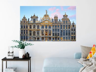 Brussels Grand Place. North-east part. Sunset evening view of row of old beautiful stone buildings facades between Rue de la Colline and Rue des Harengs. Lots of artistic golden details and