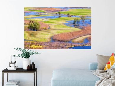 Spring landscape, panorama, banner - flood of the Siverskyi (Seversky) Donets river, the winding river flows through meadows between hills and forests, the northeast of Ukraine