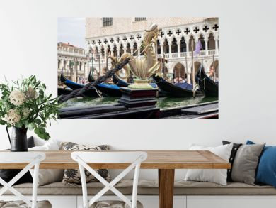 Venice, Italy. Gondola, the famous and traditional flat bottomed Venetian rowing boat. Details of the ornaments that adorn the gondola