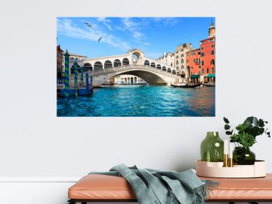 Beautiful view of the Rialto Bridge in Venice with turquoise blue water