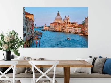 Panorama of Venice Grand Canal with boats and Santa Maria della Salute church on sunset from Ponte dell'Accademia bridge. Venice, Italy