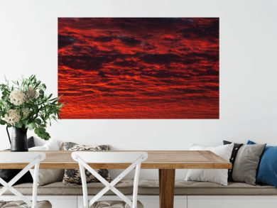Panoramic view of red evening sky. Colorful cloudy sky at sunset. Sky texture, abstract nature background