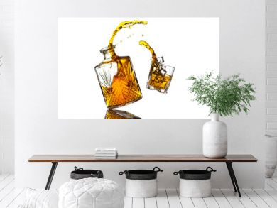 Liquor bottle and glass in mid air