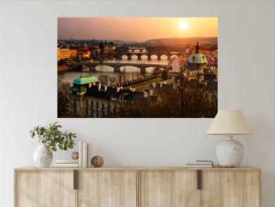 Panoramic view on Charles bridge and sunset Prague lights.