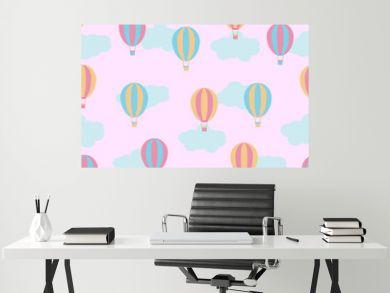 Seamless background with cute colorful hot air balloons on pink background suitable for children wallpaper, scrap paper, and postcard