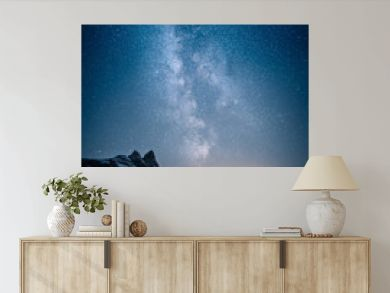 Beautiful view of milky way glowing on the sky with mountains and river and reflections of stars