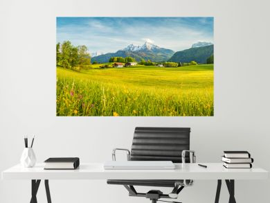 Idyllic summer landscape in the Alps with blooming meadows at sunset