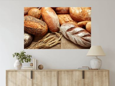 assortment of baked bread on wooden background