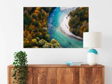 Turquoise river meandering through forested landscape