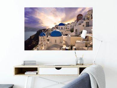 Sunset over the famous village Oia in Santorini, Greece