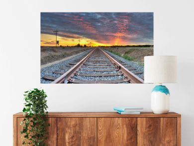 Panoramic view of railroad tracks crossing the frame from right to left.