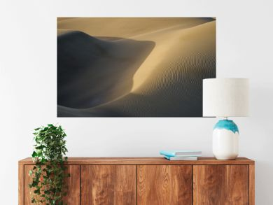 Sandy dunes in desert / Sandy and wavy dunes with stylish forms in a wide desert under blue sky