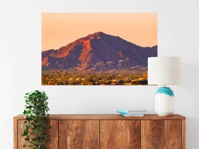 downtown Phoenix, Arizona skyline with famous camelback mountain at sunset