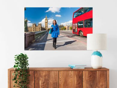 London Big Ben lifestyle tourist woman walking. Businesswoman going to work on Westminster bridge with red bus double decker background. Europe travel destination, England, Great Britain.
