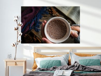 Winter hot chocolate on rustic background