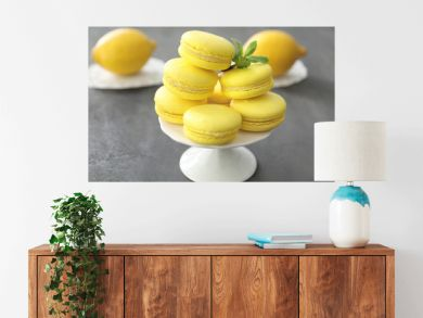 Dessert stand with tasty homemade lemon macarons on table
